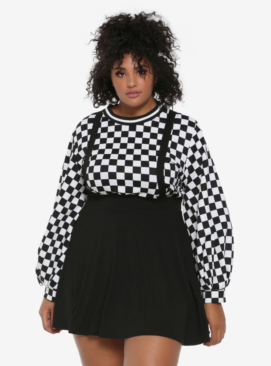 Invoke the style of a witchy schoolgirl in this black circle skirt with attached adjustable suspender straps. Pair with a white top & black knee-highs to complete your crafty look. Click here for junior sizes .