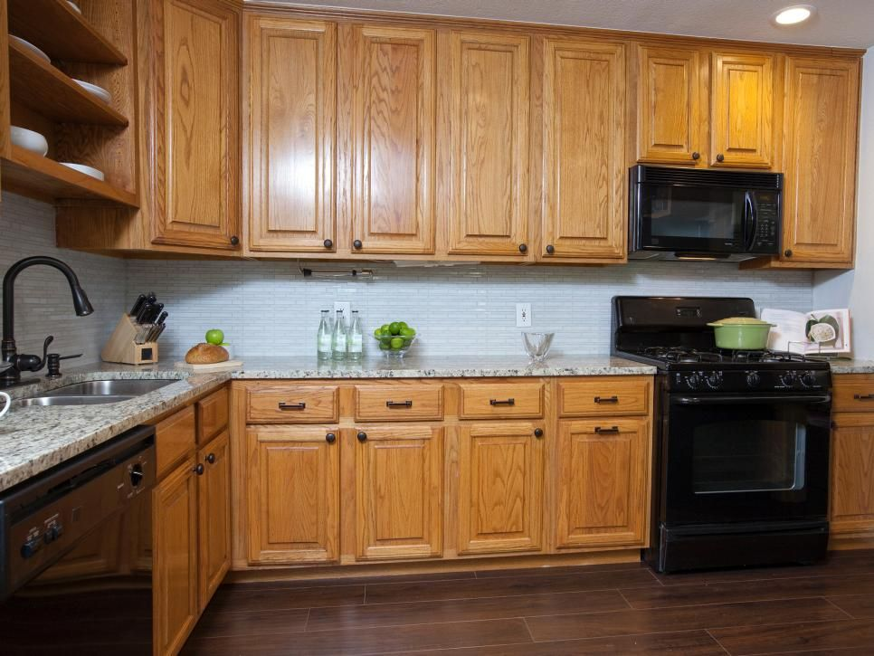 A refreshed tile backsplash and granite countertops give ...