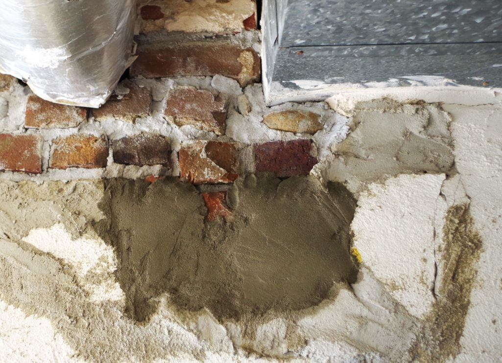 How To Fix A Big Hole In A Cement Wall Plaster Disaster In 2020 Cement Walls Plaster Walls Concrete Block Walls