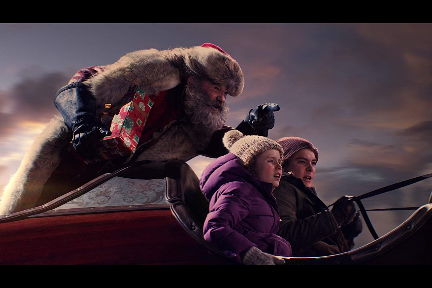 Kurt Russell, Darby Camp, and Judah Lewis in The Christmas