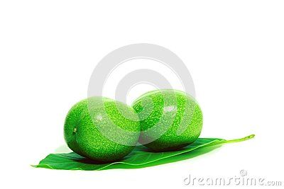 Walnuts on a green leaf on a background