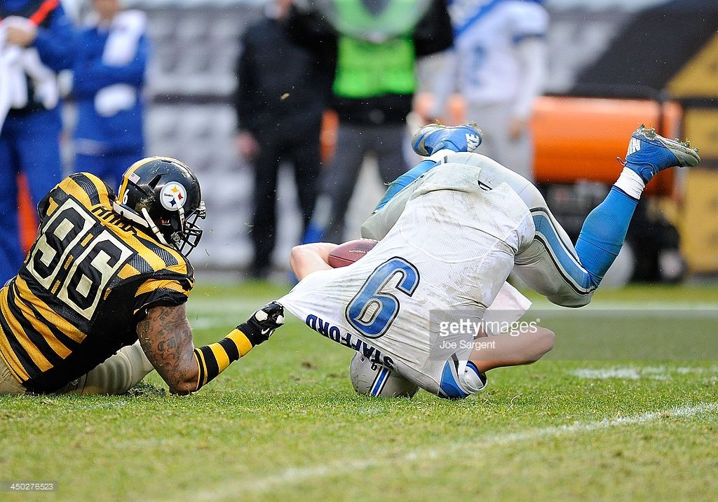 Matthew Stafford #9 of the Detroit Lions is sacked by Ziggy Hood #96 of the Pittsburgh Steelers during the fourth quarter on November 17, 2013 at Heinz Field in Pittsburgh, Pennsylvania. Pittsburgh won the game 37-27.