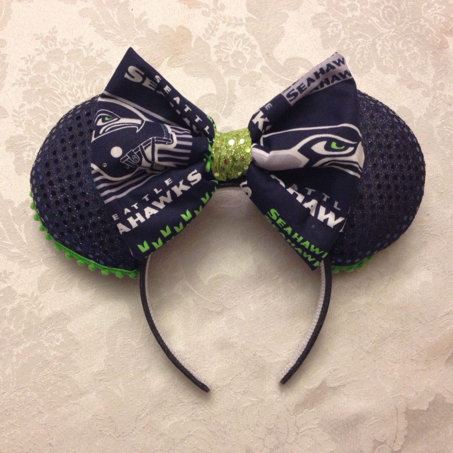 Seahawks 12th Fan Minnie Mouse Ears by secondstoretotherite on Etsy https://www.etsy.com/listing/247382914/seahawks-12th-fan-minnie-mouse-ears