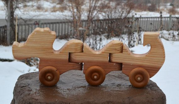 "Our wood toys are hand crafted one at a time in our shop. These toys are made in a simple, safe, durable, and classical design to encourage imagination and creativity in children.  Dimensions: 5.5"" high, 15"" long"