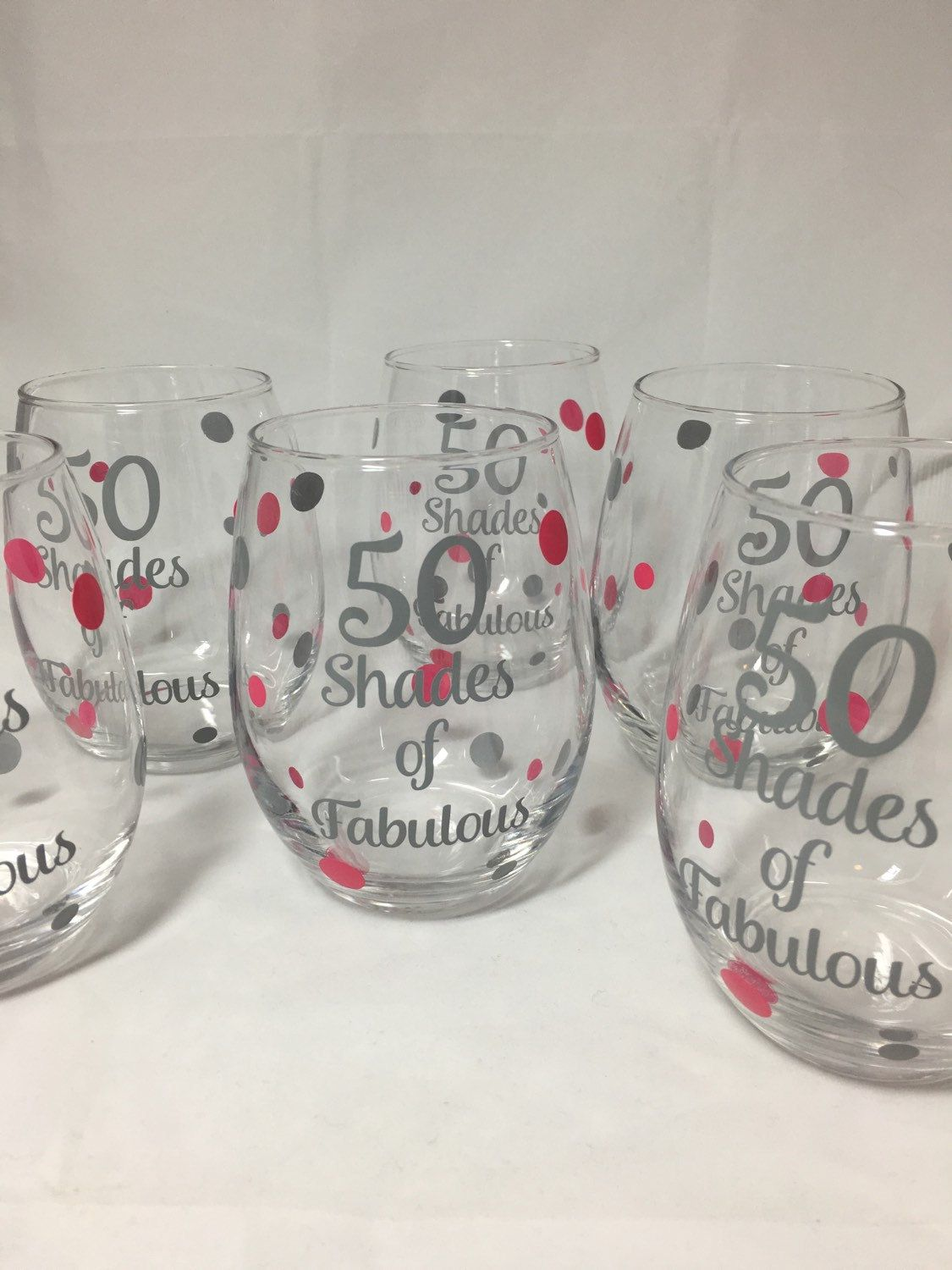 This listing is for ONE 21oz stemless wine glass. Check