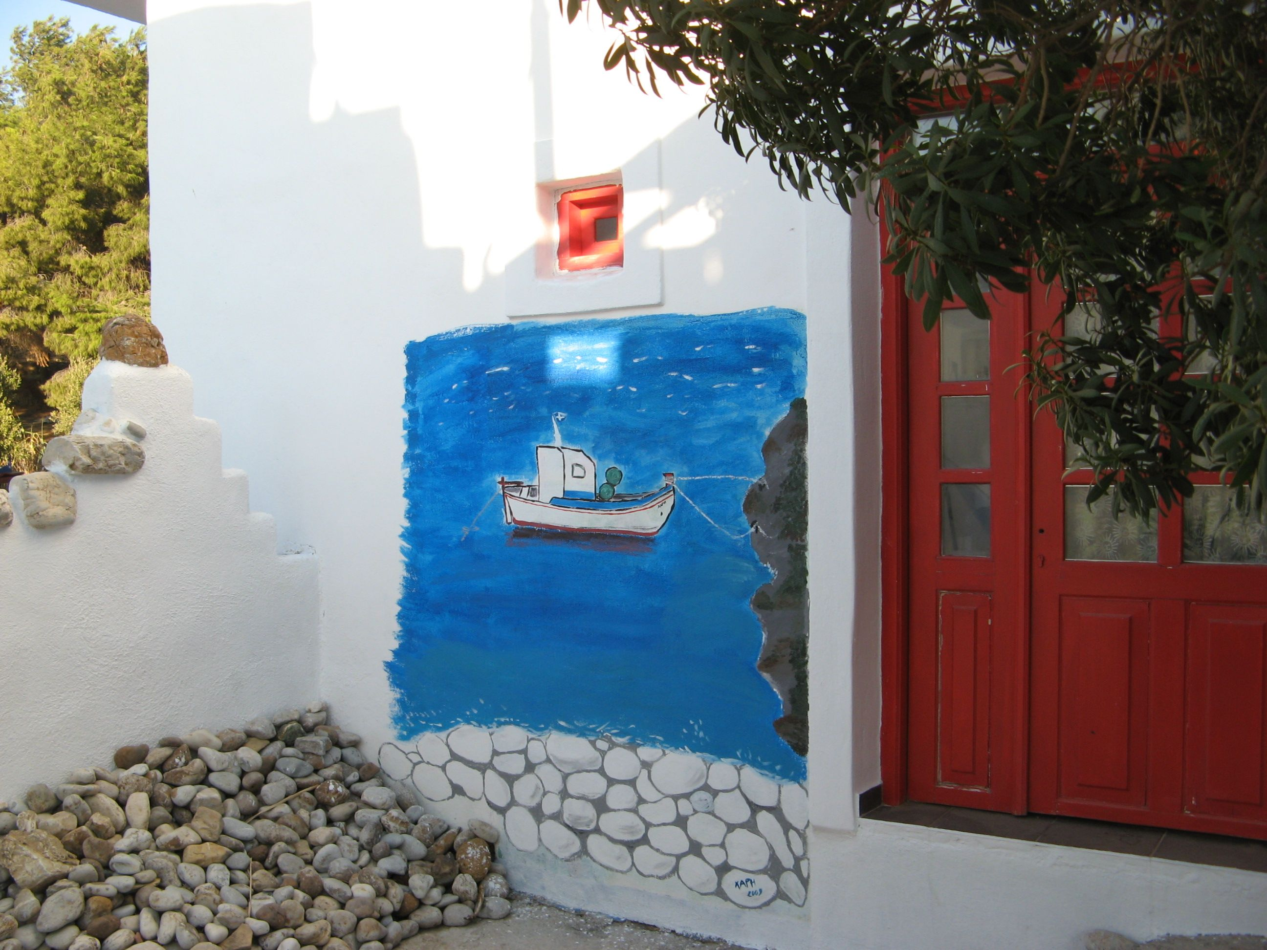 A painted boat at a cafe at Lipsi island, Greece