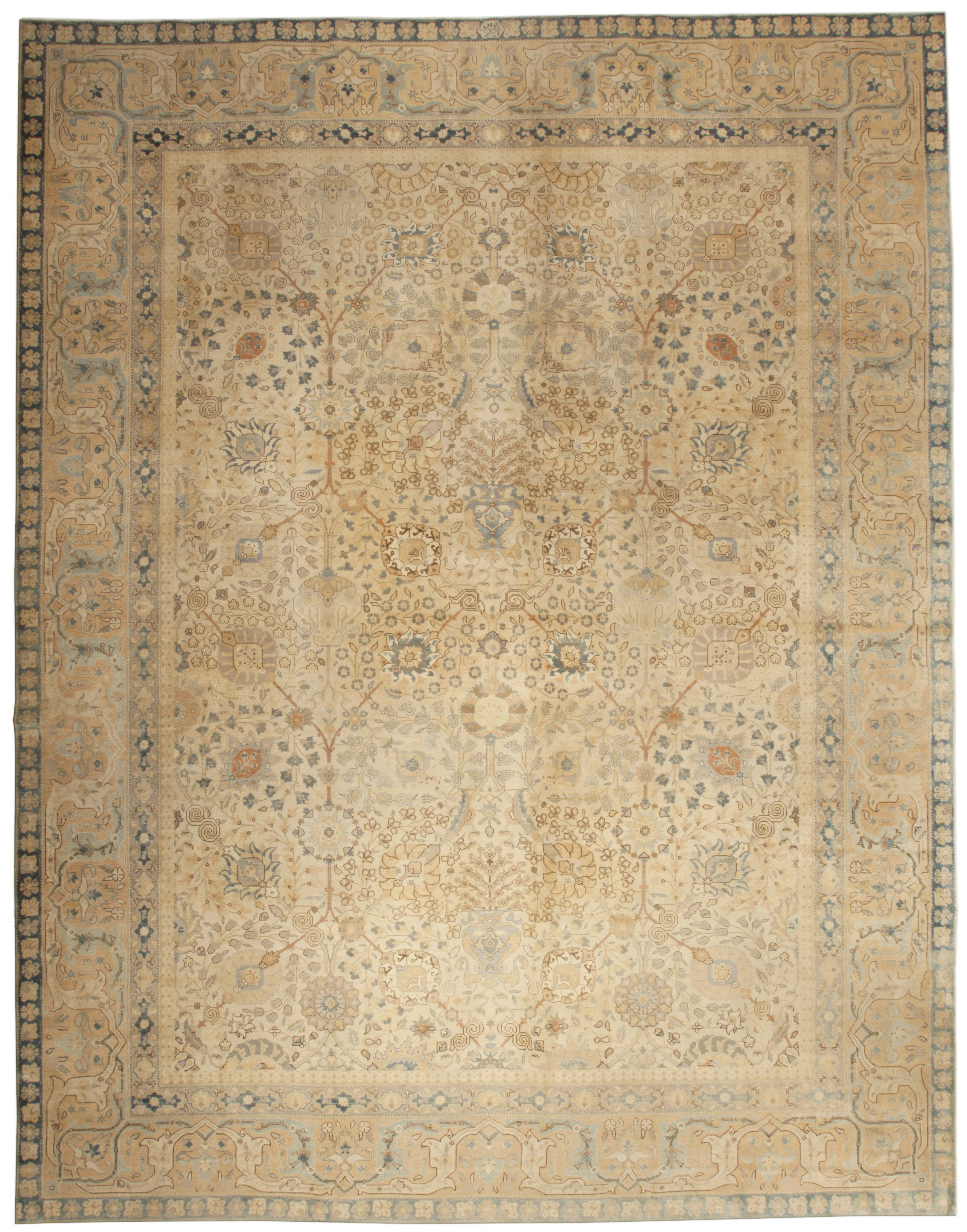 A Persian Tabriz Rug BB4938 - by Doris Leslie Blau.  An finely woven Antique Persian Tabriz Rug that has gently faded with time creating a soft palette of blues and corals with ...