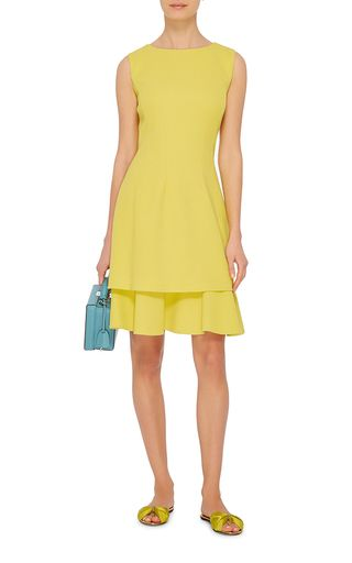 Crafted in a vibrant-hued textured wool crepe, this **Oscar de la Renta** dress features a feminine tiered skirt.