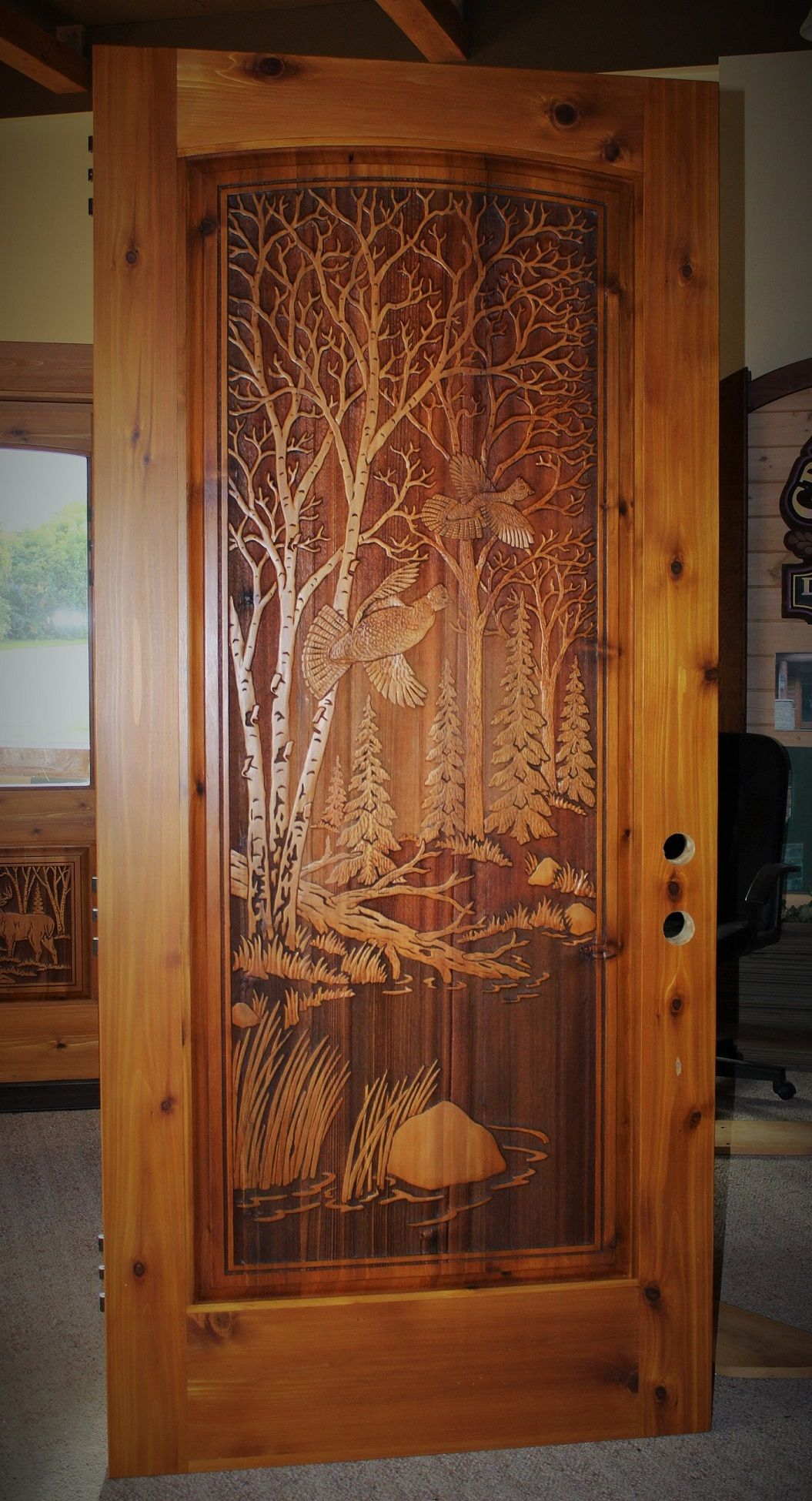 Carved wood entry door