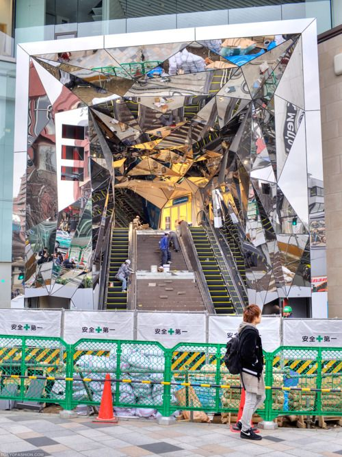 the entrance to the new tokyu plaza omotesando harajuku is covered in fractured mirrors