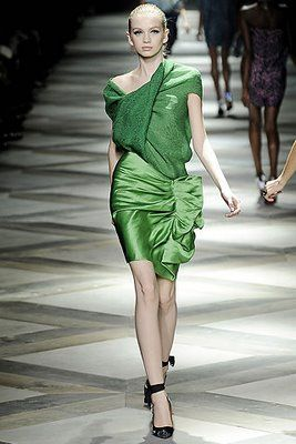 Lanvin's Spring line is fun, unique and abstract incorporating shiny satins in all colors such as black, orange, subtle rose and neon green.