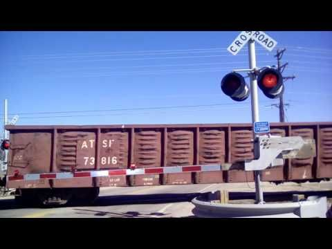BNSF is carrying a mix freight train at masaroad  railroad crossing