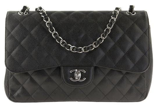1e021cd375e3 Chanel Classic Flap Jumbo In Caviar and Silver Hardware Black Leather  Shoulder Bag. Get one of the hottest styles of the season!