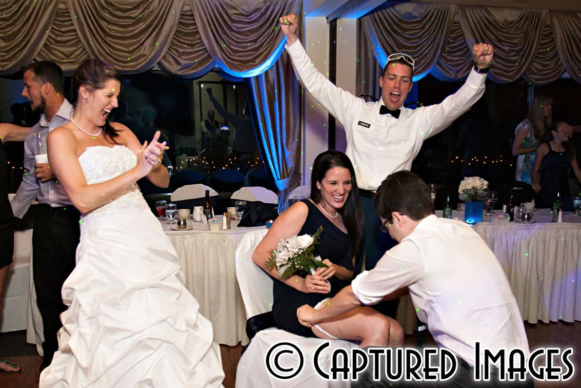Bride Groom Cheer On The Garter Tradition For Every Inch Above The Knee Another Year Of Good Luck For The Wedding Photography Mermaid Wedding Dress Bride