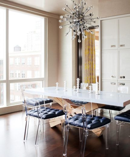 modern dining room with burst chandelier and phantom chairs