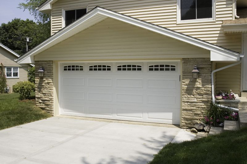 Offset The Yellow Color With A White Garage Garage Doors Doors