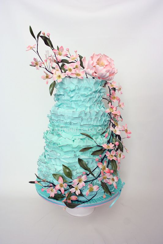 bright aqua (Tiffany blue?) wedding cake stack with graceful spray of pink flowers