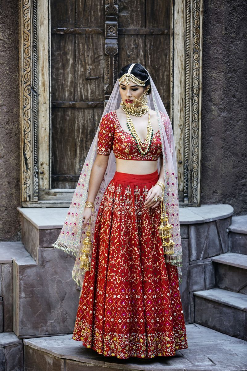 Stunning red bridal lehenga with embroidery and white dupatta for