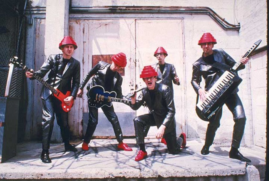 DEVO posed on a loading dock behind their rehearsal studio in Southern California. Probably 1980.