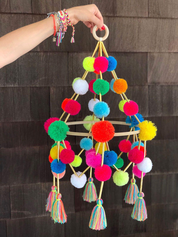 DIY Pom Pom Pajaki Chandelier is part of diy - Learn how to create pajaki chandeliers, a Polish folk decoration, using colorful pom poms and tassels!