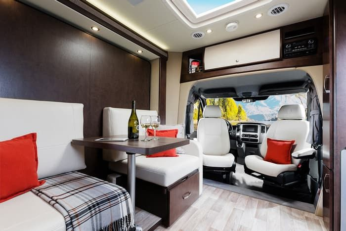 Unity motorhome combines Murphy bed and swivel recliners in comfy ...