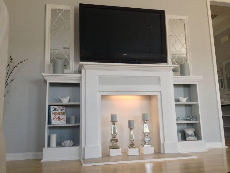 tv wand als dekokamin mit regalen und f chern einrichtung kaminumrandung dekokamin und. Black Bedroom Furniture Sets. Home Design Ideas