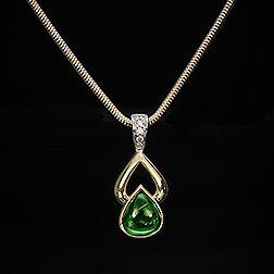 Tsavorite & Diamond Pendant, 18k Gold with Diamond accents. #Tsavorite #Gem