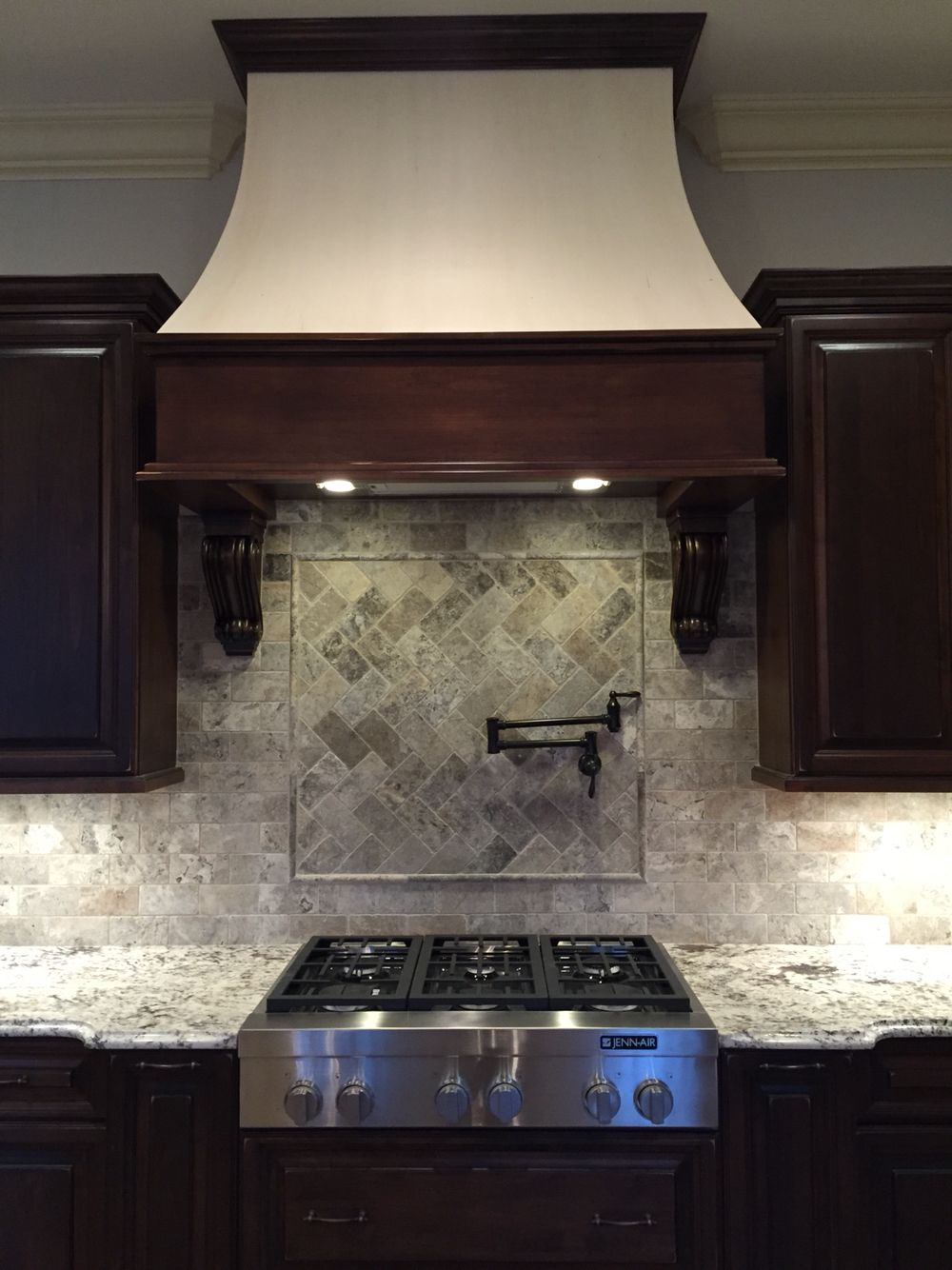 Silver Travertine backsplash with Pro Vision Cabinetry by Laurie Acree Designs Inc. #LADi