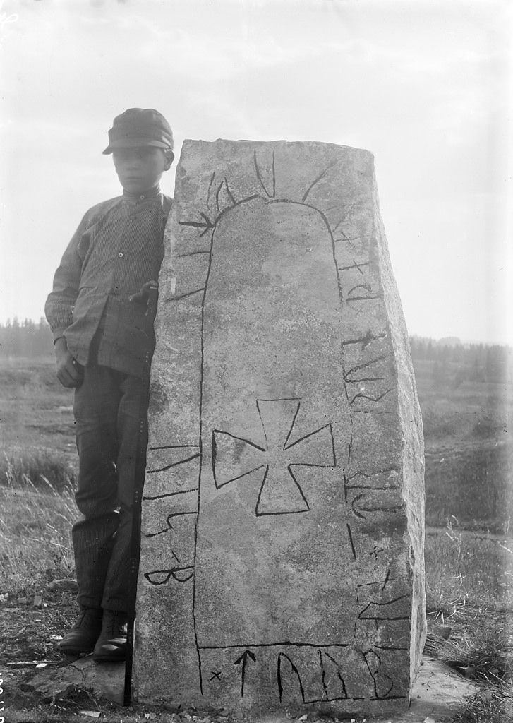 Boy At Rune Stone In Furingstad Ostergotland Sweden
