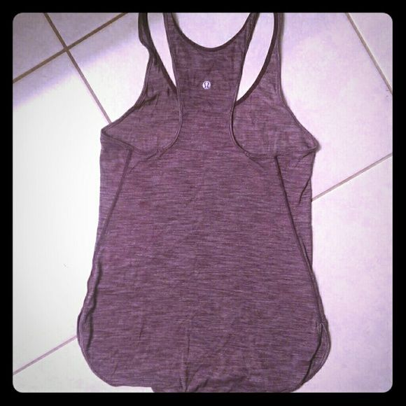Lululemon tank In perfect condition, worn once, a bit smaller than I like. In plum /heather color . willing to trade for 6-8 lululemon athletica Tops Tank Tops