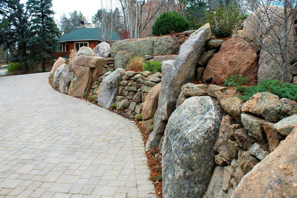 Boulder Retaining Walls Paver Driveway Landscaping With Boulders Rock Wall Landscape Terraced Landscaping