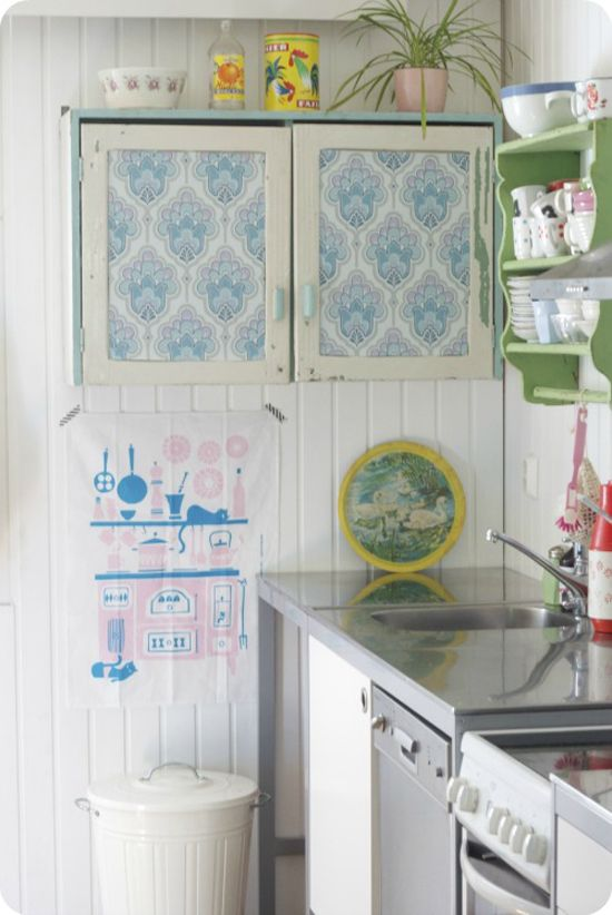 Wallpaper covered kitchen cabinets
