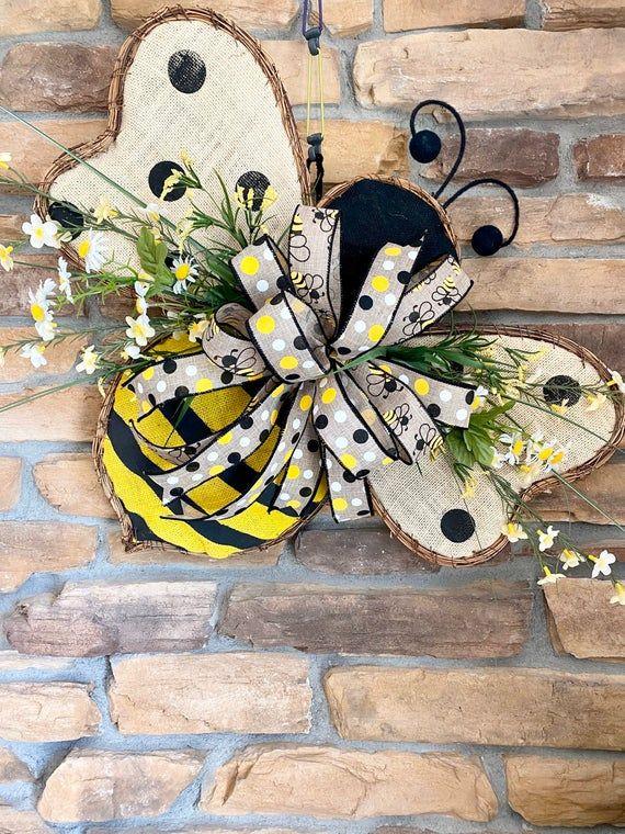 Bumble bee shaped door hanger wreath with flowers