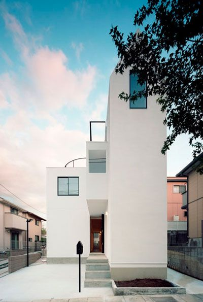Leave it to the Japanese to build a nine meters high, but less than two meters wide, house that serves 2 families - Amazing!