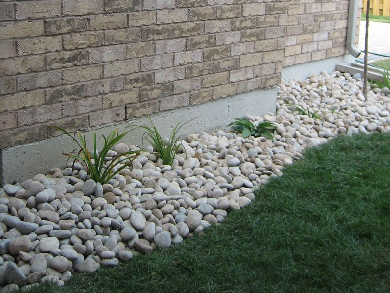 Landscaping with river rock installation front yard for Installing river rock landscaping