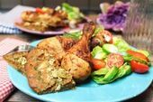 Photo of Garlic macadamia pita with a colorful salad and chicken drum…