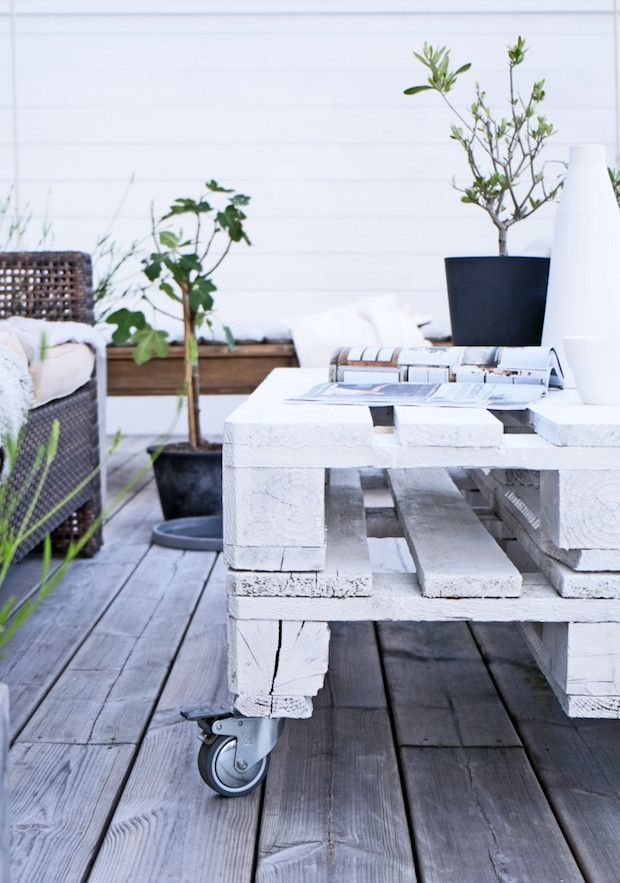 stylist design white patio table. Pallette garden table in the beautiful home of Swedish interior stylist  Pella Hedeby