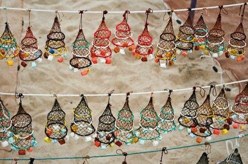 Little fishing nets made by local fisherman in Nazaré, Portugal via Dakota .D Journal