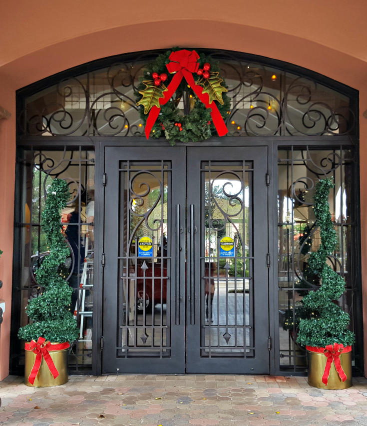 First impressions are priceless. Decorating your windows and doors for the holidays gives a warm greeting to your guest and clients. By simply adding this wreath, the business makes  a great first impression. Click on pin to contact us.