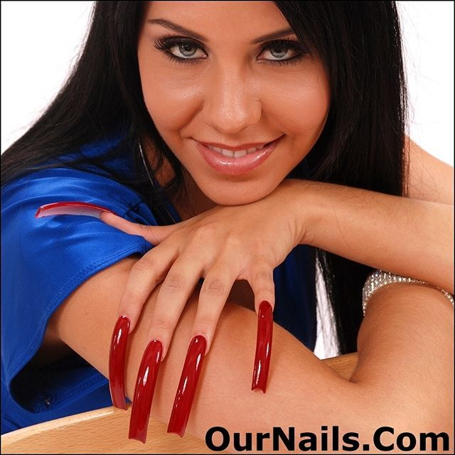 Margo from OurNails.Com modeling her beautiful cherry red nails ...