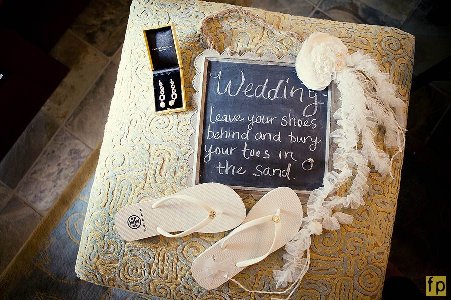 Offer guests flip flops to wear at a beach wedding - set aside an area away from sand -  where they can leave their shoes.