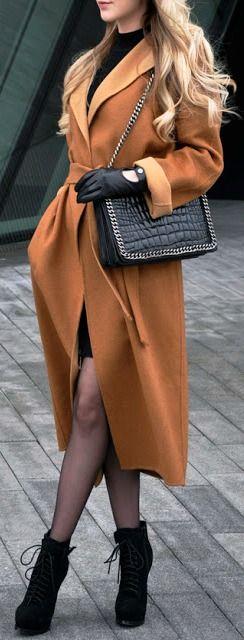 Long belted coat.