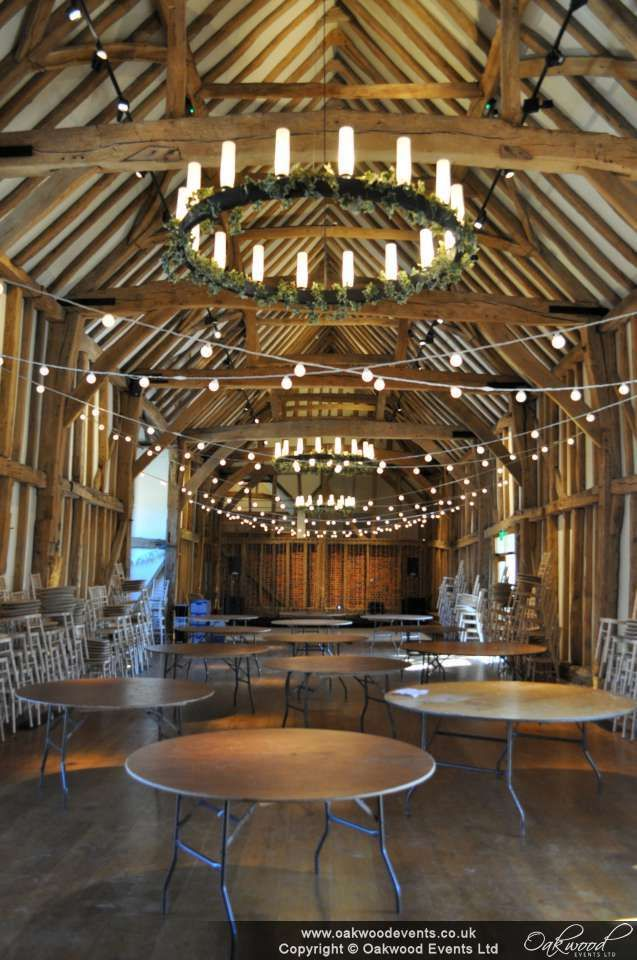 Festoon light crosses in the barn for a summer wedding at MicklefieldHall