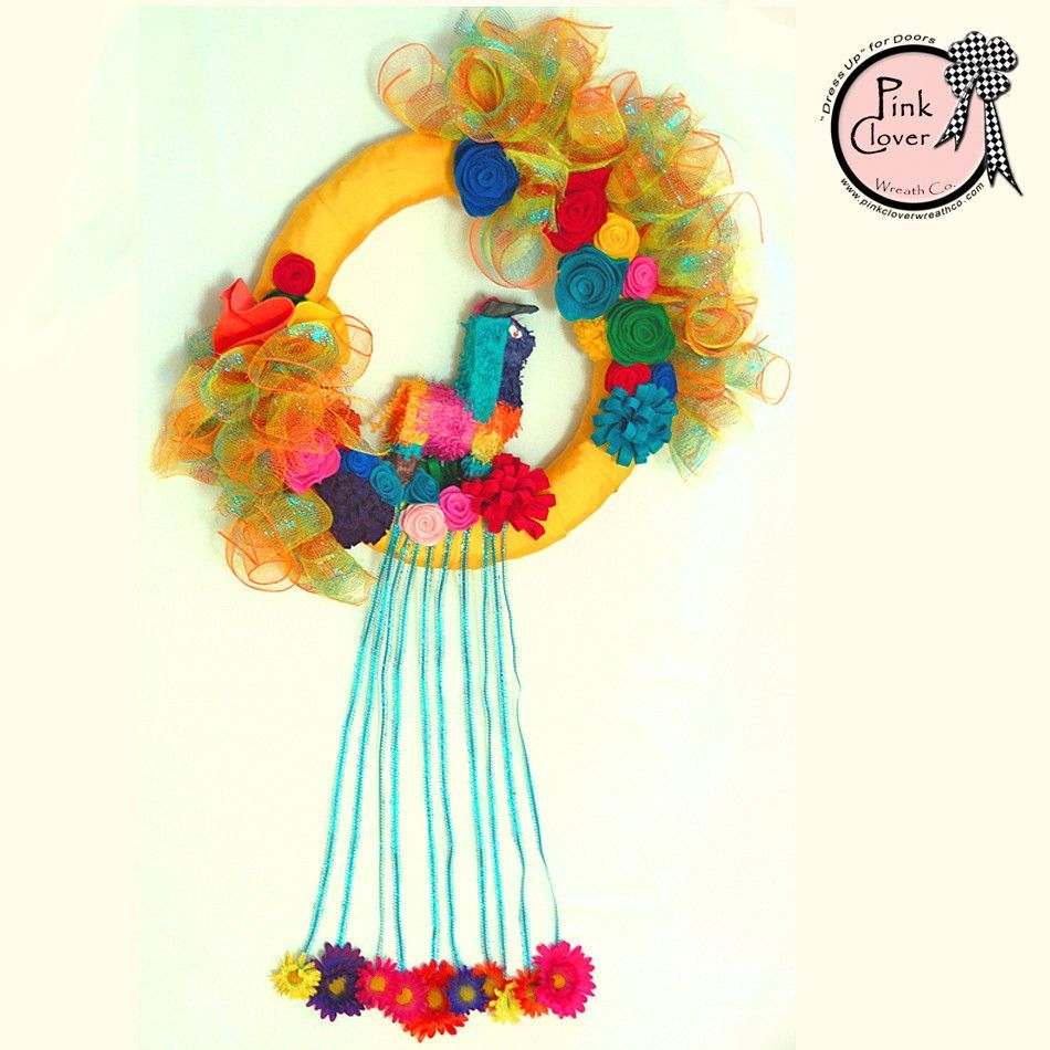 "Your home will express a party or ""fiesta"" is in the air with lots of colorful handmade felt flowers, ribbons and fighting bull piñata adorning your door. Complete your Mexican themed party inside wit"