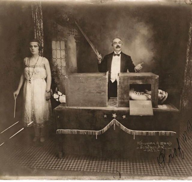 photograph of the magician professor herrmann sawing a lady in half
