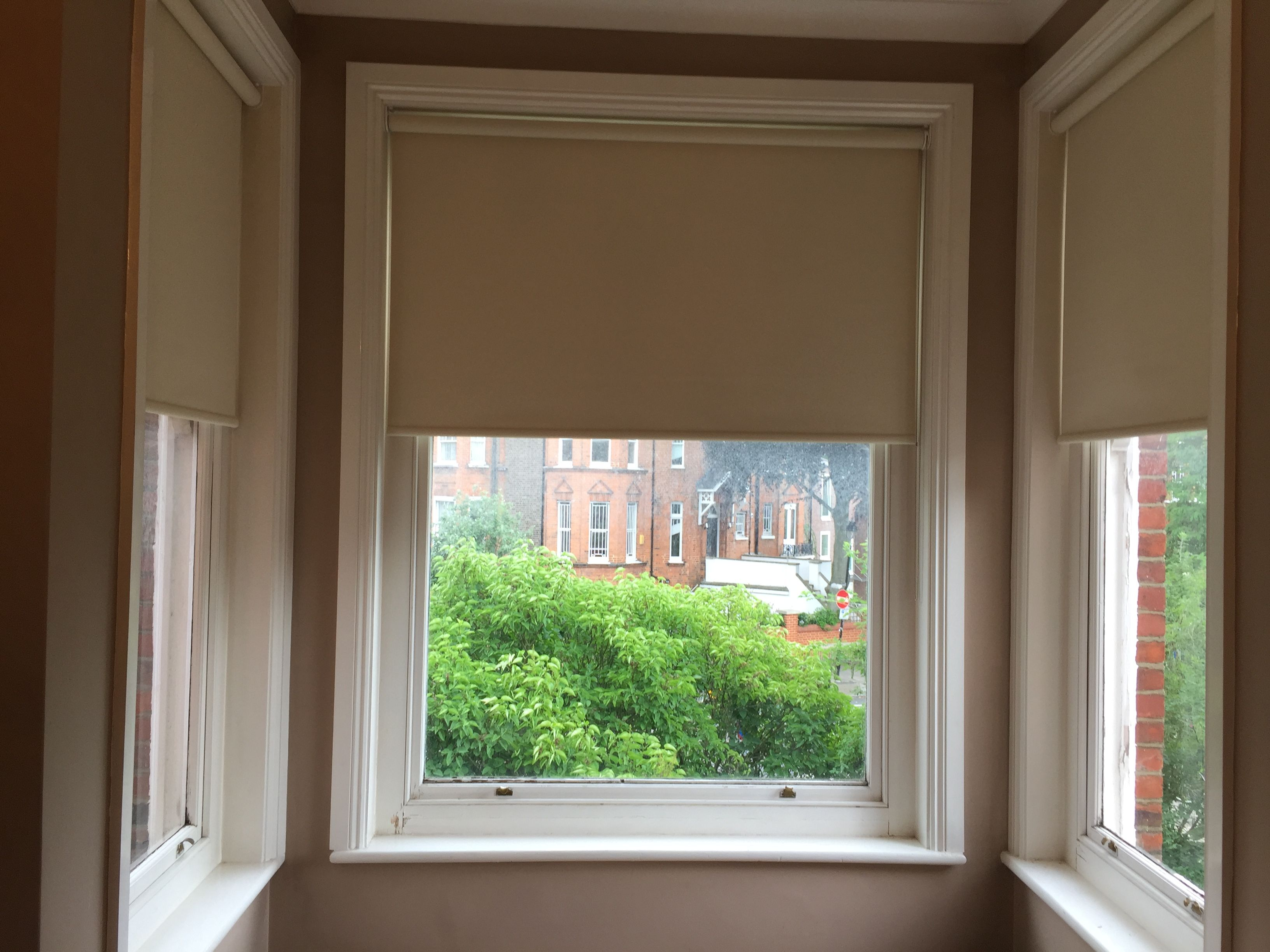 Blackout Roller Blinds Installed To Square Bay Window