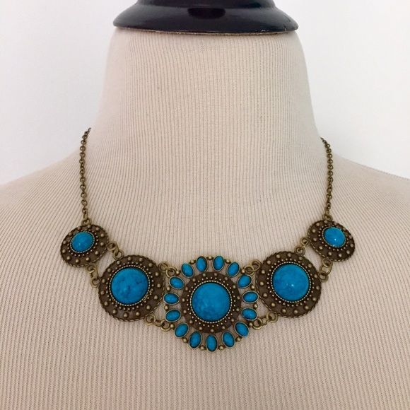 """NEW Faux Turquoise Bronze Gold Statement Necklace This NEW boho necklace is perfect for summer festivals! Features bronze tone chain with faux turquoise """"gems"""". Great statement piece. Necklace measures 18.5 inches in length. Chain can be shortened upon request.  #jewelry #bohochic #bohemian #hippie #festival #coachella #festivalwear #festivalattire #indian #southwestern #nativeamerican #boho #statementnecklace #navajo Jewelry Necklaces"""