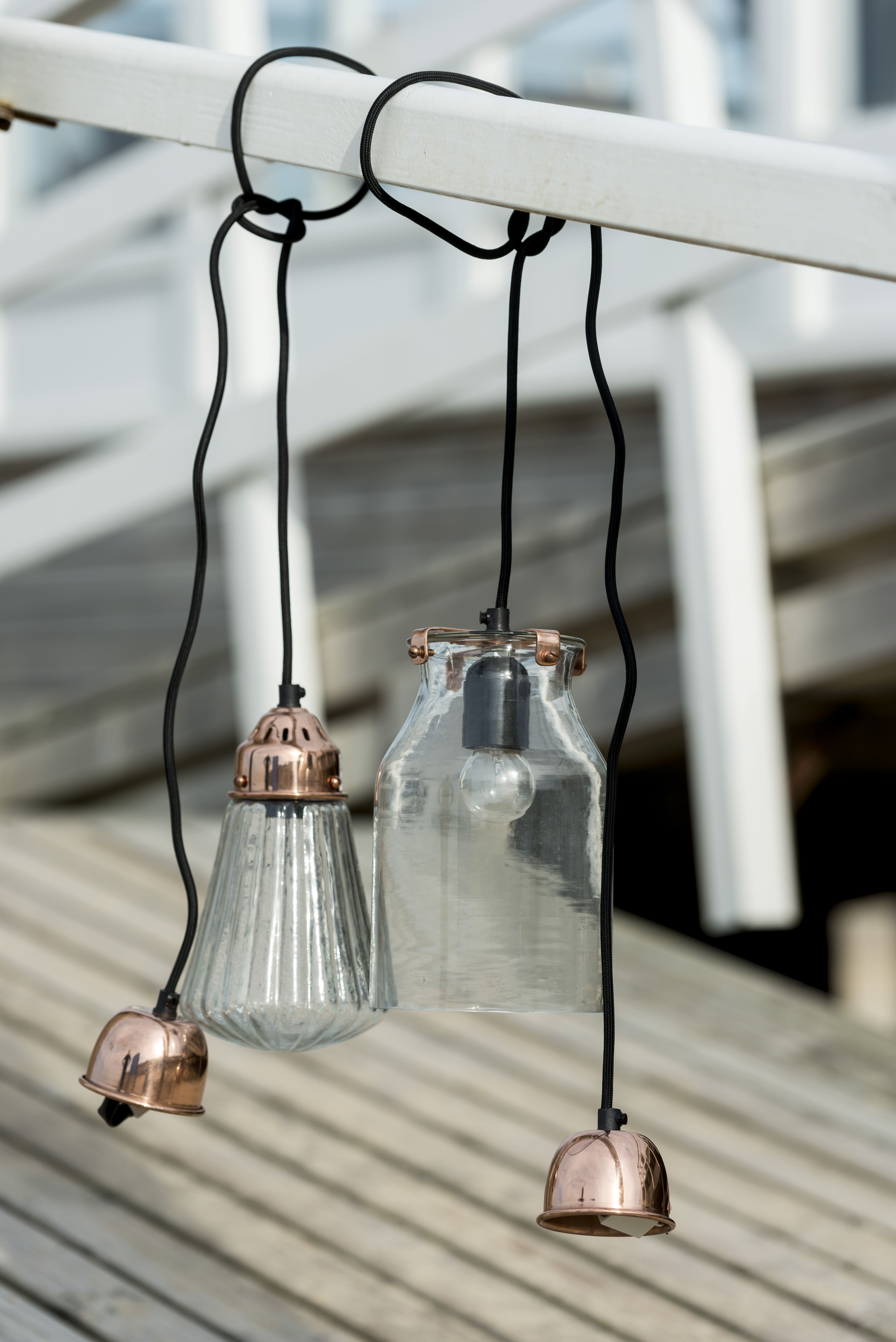 A simple but elegant and effective pendant light in decorative textured recycled clear glass. Paired with a minimal but decorative metal housing for the lamp holder and matching decorative ceiling fitting, available in two finishes.