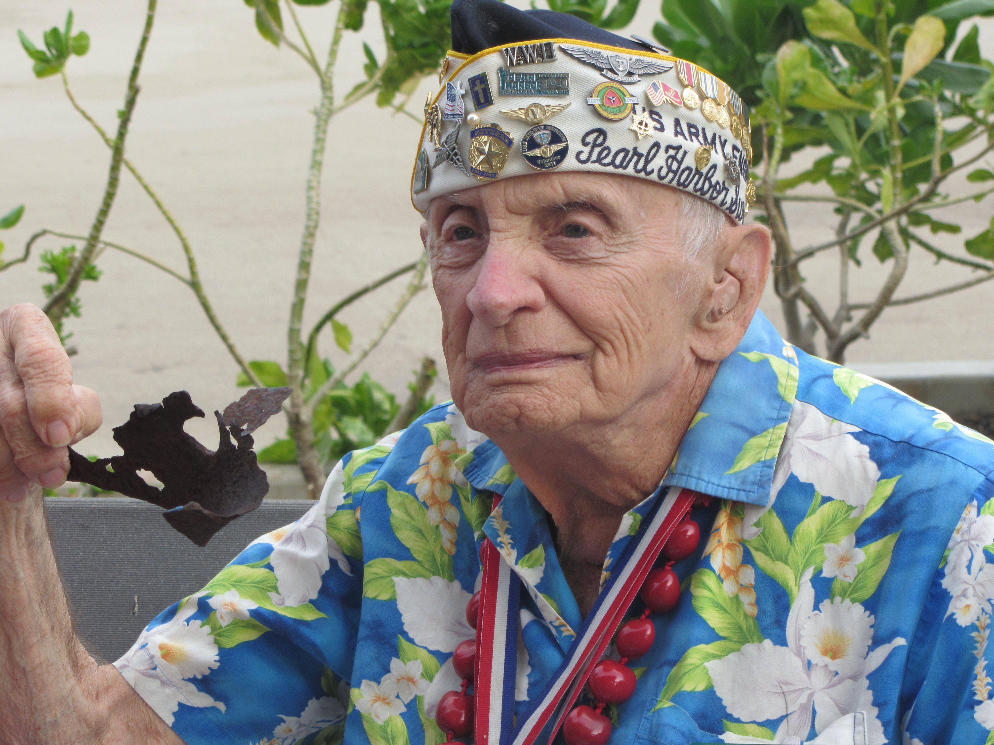 Pearl Harbor Survivor with piece of U.S.S. Arizona in his
