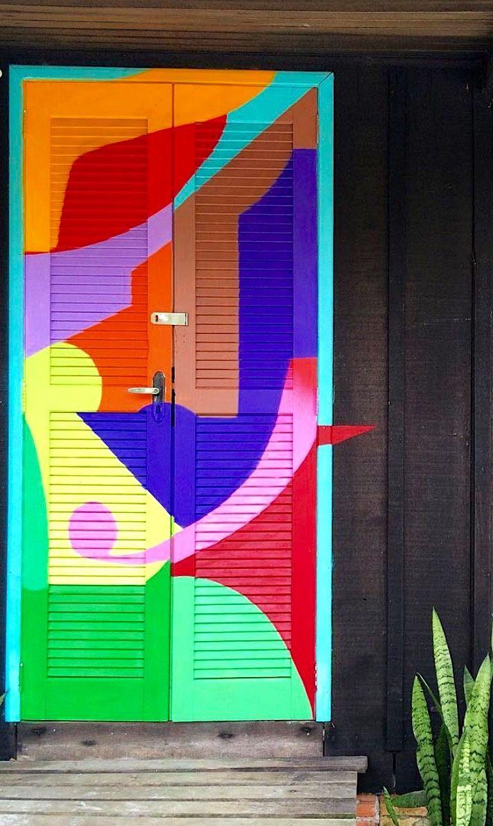 Colorful shutter doors at Pousada Beehouse in Ilha do Mel, Brazil.